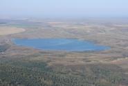 Вид с вершины на Белое озеро с островком