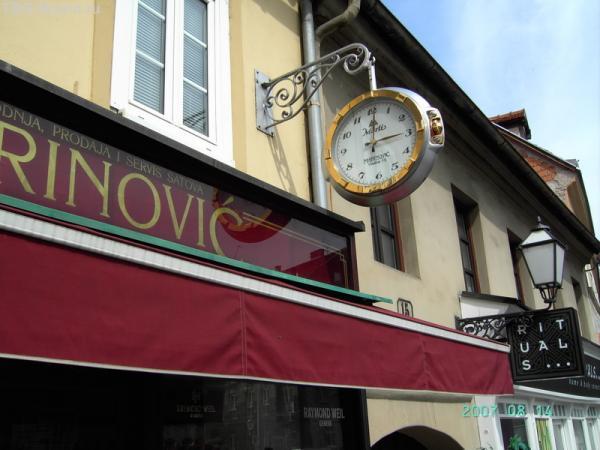 Часы-реклама часового магазина. Влажка